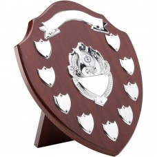 MAHOGANY SHIELD WITH CHROME FRONTS AND 9 RECORD SHIELDS (1in CENTRE) - 12.75in